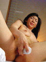 Brunette Emiko Koike does her solo with a toy