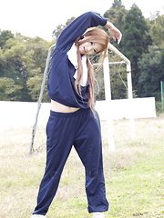 Long haired An Umemiya poses outdoor on field