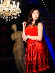 Arousing Karin Kusunoki poses in red dress