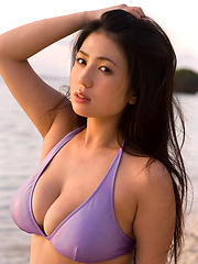 Lucious asian chick with massive tits in a tiny purple bikini