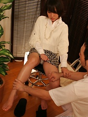 Japanese chick relaxing on massage table